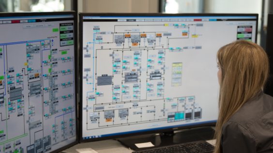 Operator monitoring plant in a control room