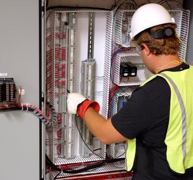 Panel Technician Testing Electrical Panel