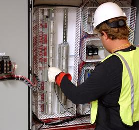 Panel Technician working in control panel